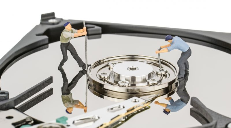 Hacking or repairing a computer hard disc drive concept